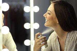 Woman applying fragrance
