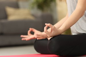 Woman hands practicing yoga