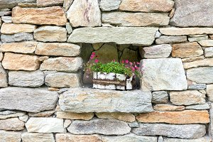 Stone wall decorated with flowers