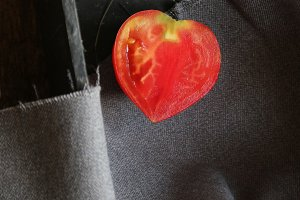 Slice of fresh tomato in heart shape