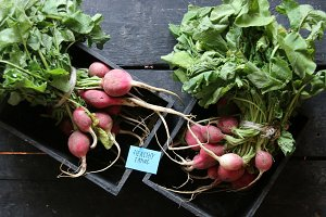 Healthy eating tag and Radish in a wooden box on the table.