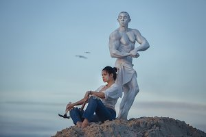 Woman and sculpture.