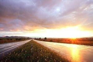Sunset on wet road