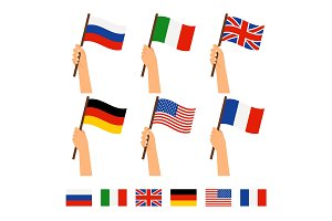 Hands holding flags of different countries