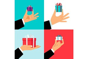 Hand holding small gift box set