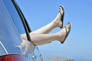 Woman with feet in the way the car