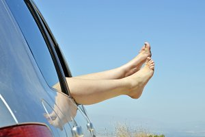 women with bare feet out the window