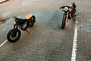 Cafe racer motorcycles on parking.