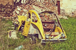 abandoned car in the ruins