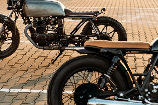 Business Stock Photos - Cafe racer motorcycles on parking.