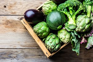 Cooking background harvest concept. Fresh organic green vegetables in wooden box
