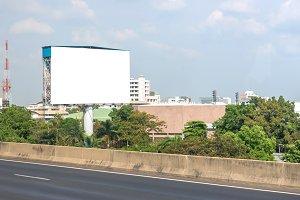 billboard blank on road in city
