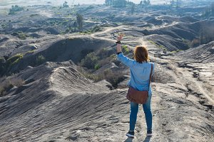 woman on top of Mount Bromo volcano