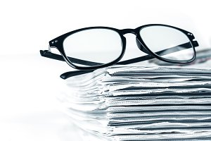 reading eyeglasses with newspaper