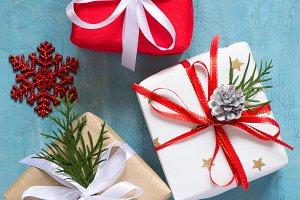 Various Christmas boxes of gifts festively decorated On a blue background