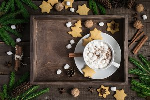 Christmas background. Tray with cocoa and cookies, decorated with cinnamon and marshmallow