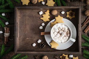 Cup of cocoa with marshmallow and a cookie in the form of stars. Christmas decor