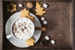 Cup of cocoa with marshmallow and a cookie In tray, christmas de