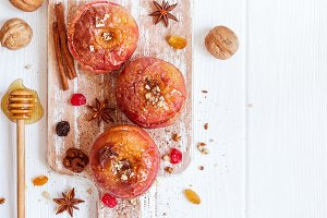 Red baked apples with cinnamon, walnuts and honey. Autumn or win