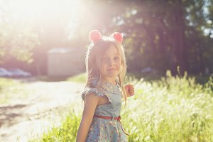 Little girl with bows in park