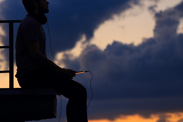 Man is listening to music on roof