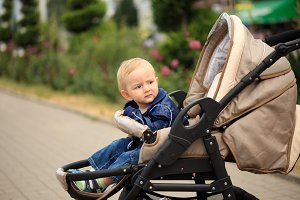 Toddler in baby carriage