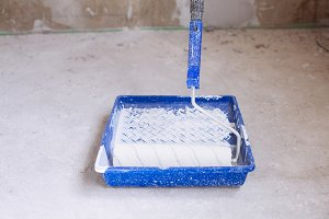 Blue bucket and brush roller paint