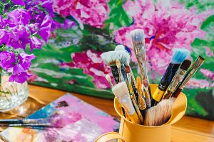 Artists brush in the studio
