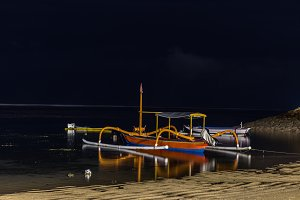 Fishing boats on the sea of tropical island Bali at night, Indonesia.