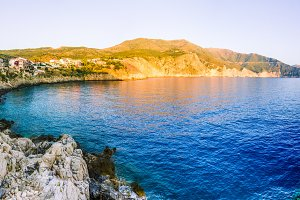 Assos village from cliffs site on evening sunset in Kefalonia, Greece