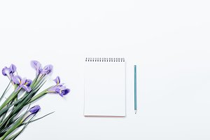 Bouquet of irises and notebook