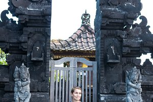Woman at the traditional balinese temple pura. Tropical island Bali, Indonesia.