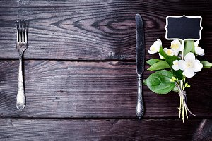 Iron fork and knife with a bouquet