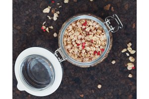 Top view on a open glass jar with granola.