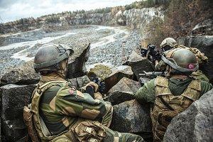 Norwegian patrol among the rocks
