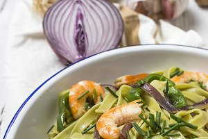 Green tagliatelle with seafood
