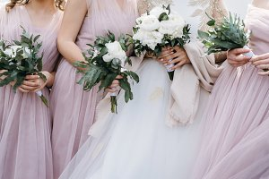 Beautiful bouquets in female hands