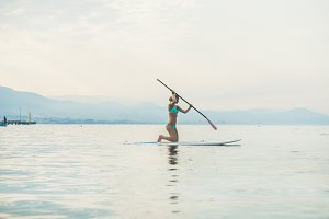 Woman practicing paddle boarding
