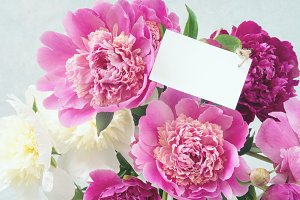 Bouquet of peonies and blank tag