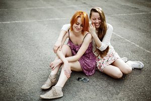 Two toung attractive girls posing