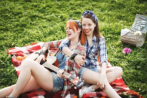 Two young hipster girls having fun