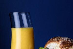 Breakfast egg sandwich, orange juice