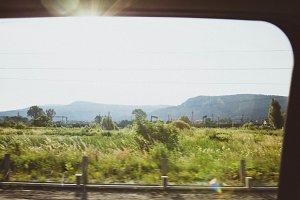 Sunny Mountains through car window