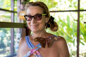 Woman in the park with Butterflies. Butterfly garden on Bali island, Indonesia.