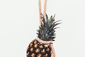 Pineapple on the wall background.