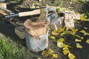 Ax chopping wood on chopping block