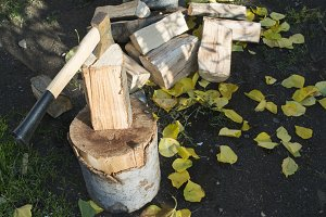 Ax chopping wood on chopping block