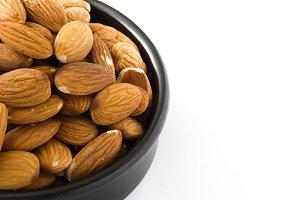 Almonds in black bowl