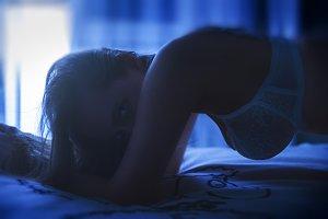 Woman portrait in the dark room