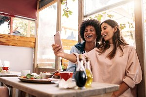 Couple having fun using smartphone